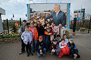 Atameken - Kazakhstan in a nutshell. Visiting school class posing with a photo of President Nursultan Nasarbaev.