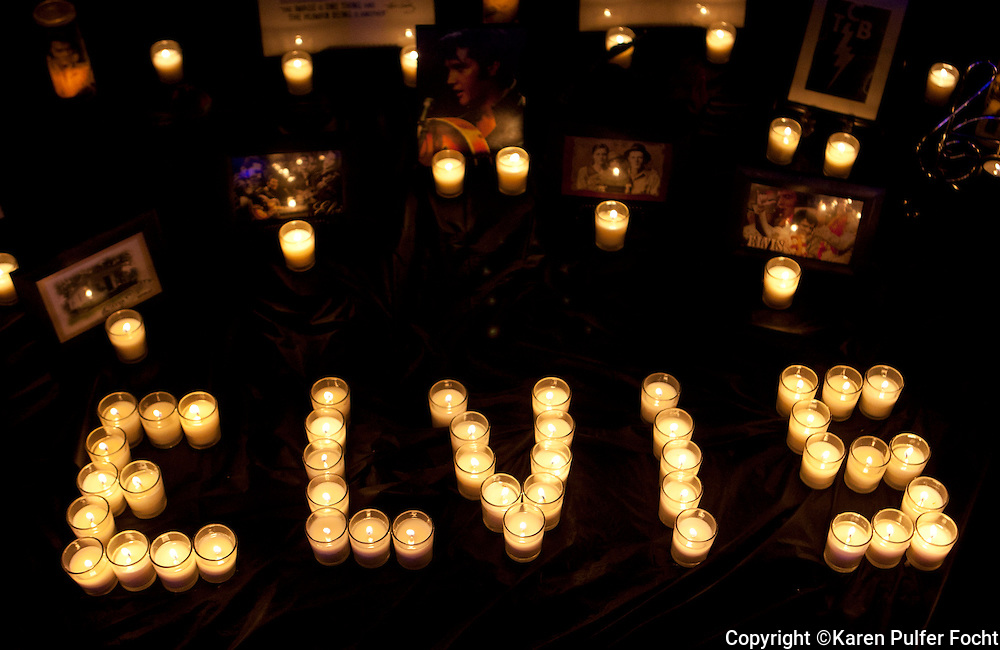 Police say about 30,000 fans participated in the Candlelight Vigil Saturday at Elvis Presley's Memphis home, Graceland, according to Graceland officials. Fans lit candles, created shrines and sang Elvis songs before the gates opened. A ceremony began about 8:30 outside of the Graceland gates and many fans processed passed the grave of the King of Rock and Roll.