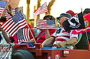 Veterans and their supporters ride along the Veteran's Day Parade route up S. 4th Street in Downtown Las Vegas on Tuesday, November 11, 2014. L.E. Baskow