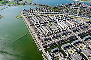 Noord-Holland, Gemeente Heerhugowaard, 20-04-2015; Stad van de Zon (Sun City) met gedeelte van centrale deel, het Carre. Nieuwbouwwijk op VINEX lokatie, in de Polder Heerhugowaard tussen de dorpskern van Heerhugowaard en Alkmaar naar ontwerp van Ashok Bhalotra. Milieuvriendelijke en energieneutrale wijk met energiezuinige huizen, uitgerust met zonne-energie panelen,  CO2-emissieneutraliteit.<br /> Sun City, new housing estate in Northwest of the Netherlands with energy neutral and environmetal friendly houses, equiped with individual solar panels. <br /> luchtfoto (toeslag op standard tarieven);<br /> aerial photo (additional fee required);<br /> copyright foto/photo Siebe Swart