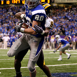 Dec 20, 2009; New Orleans, LA, USA; Middle Tennessee State Blue Raiders wide receiver Garrett Andrews (80) catches a touchdown over Middle Tennessee State Blue Raiders safety Sammy Seamster (8) during the first half of the 2009 New Orleans Bowl at the Louisiana Superdome.  Mandatory Credit: Derick E. Hingle-US PRESSWIRE