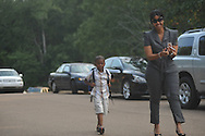 Roman Gregory walks into school on the first day of school at Bramlett Elementary in Oxford, Miss. on Thursday, August 4, 2011.