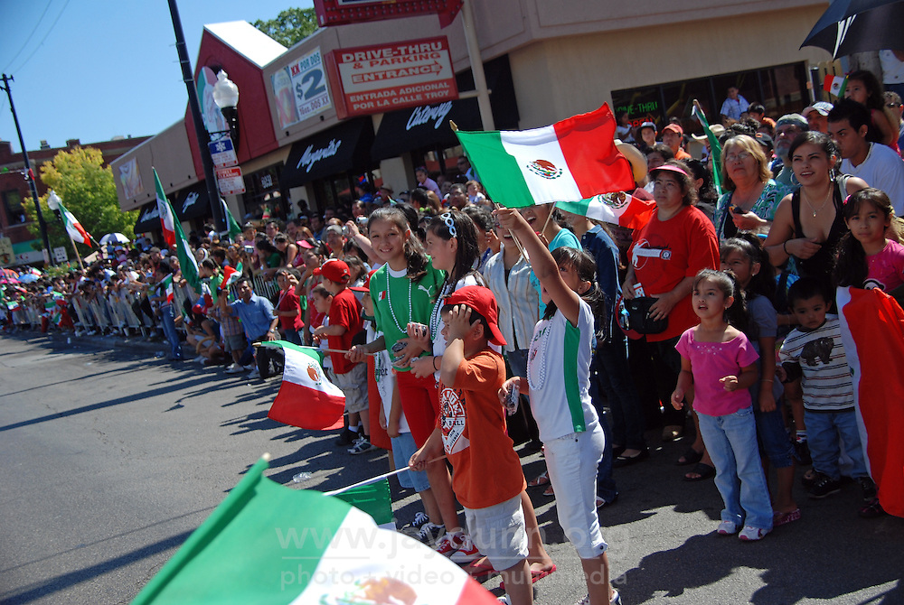 """USA, Chicago, IL, September 13, 2009. The neighborhood of """"La Villita,"""" or """"Little Village"""" is host to one of the best-attended parades celebrating Mexico's Independence Day, with enthusiastic and vocal crowds lining the whole route along 26th St. from Kedzie west to Kostner. Photographs for an HOY newspaper front page story."""