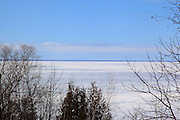 Green Bay remains completely frozen on March 17, 2013. This image captures the harsh conditions at Brown County's Bayshore Park. Winter weather extended into May in 2013.