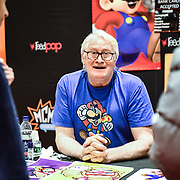 London, UK. 27th October, 2019. Charles Martinet singing autography at the MCM Comic Con London 2019, last day which took place at the Excel Centre with hundreds of stall exhibition. The weekend offered comic fans the chance to dress up as their favourite characters. Credit: Picture Capital