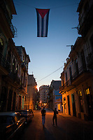 cuban flag over havana at night