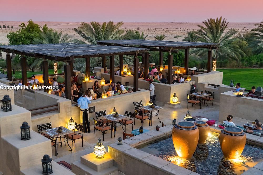 Dusk at rooftop bar at Bab al Shams desert hotel and resort in Dubai United Arab Emirates