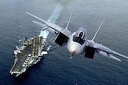 F-14 low pass over USS Kitty Hawk CV-63