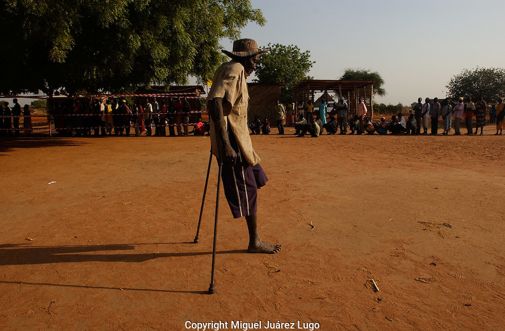 80 year old, Andrea Logun, walks away after voting in a poll station in the town of Somba, some 15 milles northwest of Juba. South Sudan is holding a Referendum for Independence. Logun is a veteran of the decades long armed struggled against the north and he lost his left leg in the battlefield. (PHOTO: MIGUEL JUAREZ LUGO).