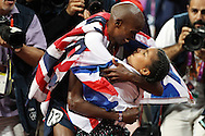Great Britain's Mohamed Farah hugs his daughter, Rihanna Farah, Saturday, Aug. 4, 2012 as he celebrates his gold medal win in the 10,000 meter final at the 2012 Olympic Games in London. Great Britain had big wins at Olympic Stadium on Super Saturday, a day where 25 gold medals were up for grabs. Great Britain added three gold medals at the track, taking wins in the 10,000 meter, the women's heptathlon and the men's long jump.