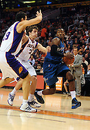Dec. 5 2010; Phoenix, AZ, USA; Washington Wizards guard John Wall (2) handles the ball while being guarded by Phoenix Suns forward Hedo Turkoglu (19) and Goran Dragic (2) during the first half at the US Airways Center. The Suns defeated the Wizards 125-108. Mandatory Credit: Jennifer Stewart-US PRESSWIRE.
