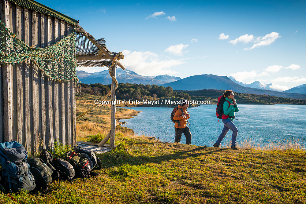Ushuaia, Tierra del Fuego, Argentina, June 2017. Taking a boat excursion in the Beagle Channel we are greeted greeted by humpback whales, sea lions, condors and gentoo penguins agains a wild mountainous backdrop with spectacular skies. The trip includes lunch in an old sheep farmer's shack and a hike on Gable Island. Photo by Frits Meyst / MeystPhoto.com