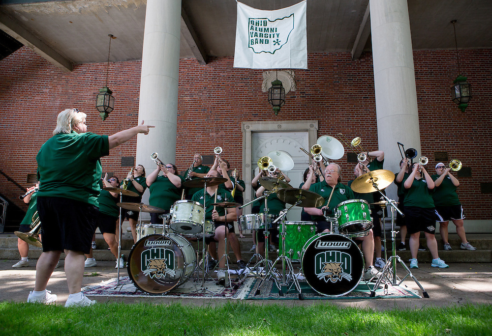 "Members of the Ohio Alumni Varsity Band perform for Ohio Univeristy alumni and their families during a barbecue on the College Green on May 31, 2014. The event was part of the ""On The Green"" weekend, hosted by the Ohio University Alumni Association. Photo by Lauren Pond"