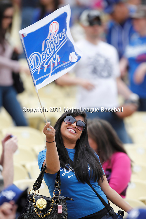 LOS ANGELES - JUNE 19:  A fan waves a team flag at the Los Angeles Dodgers game against the Houston Astros at Dodger Stadium on Sunday, June 19, 2011 in Los Angeles, California.  The Dodgers defeated the Astros 1-0.  (Photo by Paul Spinelli/MLB Photos via Getty Images)