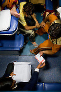 On his return trip after an 8 day holiday in Srinagar, Kashmir, Kishore Raj Bal (right), a dry fruits business owner and his extended family from Rajasthan and Bhopal pass their tickets to the Train Ticket Examiner...Train passengers settle in to their berths in the air-conditioned coach on the Himsagar Express 6318 going from Jammu Tawi station to Kanyakumari on 7th July 2009.. .6318 / Himsagar Express, India's longest single train journey, spanning over 3720 kms, going from the mountains (Hima) to the seas (Sagar), from Jammu and Kashmir state in the Indian Himalayas to Kanyakumari, the southern-most tip of India..Photo by Suzanne Lee / for The National.