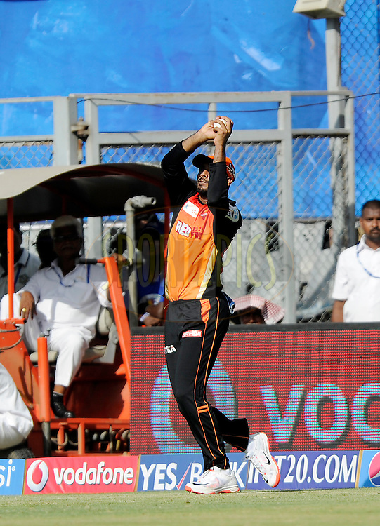 Gade Hanuma Vihari of Sunrisers Hyderabad takes a catch to get the wicket of Parthiv Patel of Mumbai Indians during match 23 of the Pepsi IPL 2015 (Indian Premier League) between The Mumbai Indians and The Sunrisers Hyferabad held at the Wankhede Stadium in Mumbai India on the 25th April 2015.<br /> <br /> Photo by:  Pal Pillai / SPORTZPICS / IPL