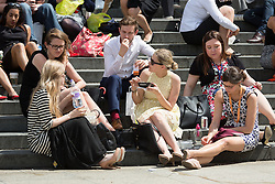 © Licensed to London News Pictures. 19/05/2014. London, UK. People enjoying the sunshine and good weather at lunchtime near St Paul's Cathedral in London on 19th May 2014. Photo credit : Vickie Flores/LNP