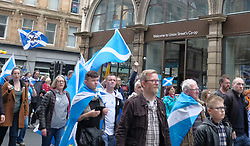 All Under One Banner March For Independence, Glasgow, Saturday 5th May 2018<br /> <br /> Thousands of people joined a march in support of Scottish Independence today in Glasgow.<br /> <br /> There were flags of many countries represented.<br /> <br /> Marchers make their way down Union Street which may be looking for a change of name if Scots vote for independence<br /> <br /> Alex Todd | EEm