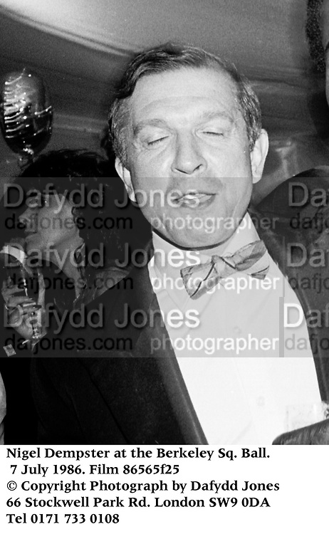 Nigel Dempster at the Berkeley Sq. Ball. 7 July 1986. Film 86565f25<br />&copy; Copyright Photograph by Dafydd Jones<br />66 Stockwell Park Rd. London SW9 0DA<br />Tel 0171 733 0108