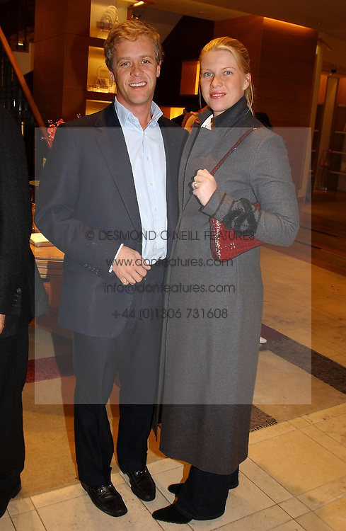 PETER &amp; SOPHIA THOMPSON at a party hosted by Burberry to launch their special collection in aid of Breakthrough Breast Cancer, held at 21-23 New Bond Street, London W1 on 5th October 2004.<br /><br />NON EXCLUSIVE - WORLD RIGHTS