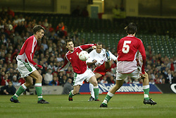 CARDIFF, WALES - WEDNESDAY FEBRUARY 9th 2005: Wales' Robert Earnshaw shoots under pressure from a Hungary player during the International Friendly match at the Millennium Stadium. (Pic by Jason Cairnduff/Propaganda)
