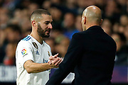 Real Madrid's French forward Karim Benzema shakes hands with Real Madrid's French coach Zinedine Zidane during the Spanish championship Liga football match between Atletico Madrid and Real Madrid on November 18, 2017 at the Wanda Metropolitano in Madrid, Spain - Photo Benjamin Cremel / ProSportsImages / DPPI