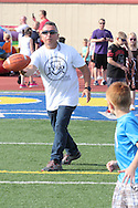 Ron Tijerina of McClure, Ohio throws a ball to Dawson Tijerina, 7 of Colgate, Ohio (right) during the All Pro Dad Father & Kids NFL Experience at Welcome Stadium, Saturday, June 18, 2016.