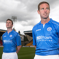 St Johnstone players Steven MacLean and Tam Scobbie pictured at McDiarmid Park today wearing the new Saints home kit for the 2014-15 season.....26.06.14<br /> Picture by Graeme Hart.<br /> Copyright Perthshire Picture Agency<br /> Tel: 01738 623350  Mobile: 07990 594431