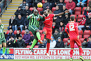 Bayo Akinfenwa of AFC Wimbledon and Jean-Yves M'voto of Leyton Orient tussle during Sky Bet League 2 match between Leyton Orient and AFC Wimbledon at the Matchroom Stadium, London, England on 28 November 2015. Photo by Stuart Butcher.
