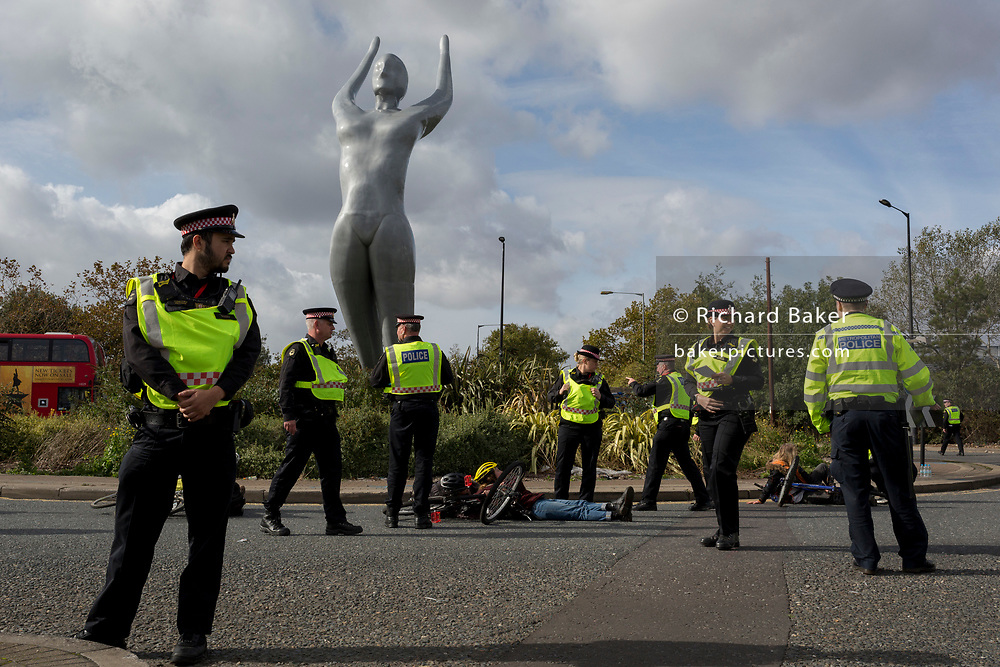 Environmental activist are arrested while protesting about Climate Change during the occupation of City Airport (London's Business Travel hub) in east London, the fourth day of a two-week prolonged worldwide protest by members of Extinction Rebellion, on 10th October 2019, in London, England.