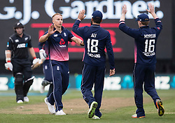England's Tom Curran, left, celebrates taking the wicket of New Zealand's Tom Latham with Moeen Ali and Eoin Morgan in the fourth one day cricket international at the University of Otago Oval, Dunedin, New Zealand, Wednesday, March 7, 2018. Credit:SNPA / Adam Binns ** NO ARCHIVING**