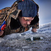 "Even for recreational fishermen, the diminishing fish stock is keenly felt. Here Yuri stares through an ice hole to look for fish along the northern shore at Russia's Lake Baikal. <br /> <br /> Crowned the ""Jewel of Siberia"", Baikal is the world's deepest lake, and the biggest lake by volume, holding 20% of the world's fresh water. In the winter, the lake 31,722 square meter surface is entirely frozen with ice averaging 2 meters thick."