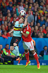 LILLE, FRANCE - Friday, July 1, 2016: Wales' captain Ashley Williams in action against Belgium's Kevin De Bruyne during the UEFA Euro 2016 Championship Quarter-Final match at the Stade Pierre Mauroy. (Pic by David Rawcliffe/Propaganda)