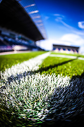 The corner flag casts a shadow on the new pitch at The Falkirk Stadium, for the Scottish Championship game v Hamilton. The woven GreenFields MX synthetic turf and the surface has been specifically designed for football with 50mm tufts compared with the longer 65mm which has been used for mixed football and rugby uses.  It is fully FFA two star compliant and conforms to rules laid out by the SPL and SFL.<br />