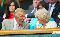 LONDON, ENGLAND - Wednesday, June 27, 2012: Bruce Forsyth shares a joke with Camilla Parker Bowles (Duchess of Cornwall) during the Ladies' Singles 1st Round match on day three of the Wimbledon Lawn Tennis Championships at the All England Lawn Tennis and Croquet Club. (Pic by David Rawcliffe/Propaganda)