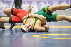 London, Ontario ---2013-03-02--- Matt Fedler of The University Of Regina takes on Mehrdad Pourkamali of York in the men's 68 KG 7th/8th match at the 2013 CIS Wrestling Championships in London, Ontario, March 02, 2013. .GEOFF ROBINS/Mundo Sport Images