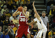 21 JANUARY 2009: Wisconsin's Jon Leuer (30) looks for someone to pass to while being defended by Iowa's Matt Gatens (5) during the first half of an NCAA college basketball game Wednesday, Jan. 21, 2009, at Carver-Hawkeye Arena in Iowa City, Iowa. Iowa defeated Wisconsin 73-69 in overtime.