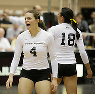 West Point, NY - An Army player shouts encouragement to her teammates during a match against Lehigh in the Patriot League women's volleyball tournament at the United States Military Academy on  Nov. 21, 2009.