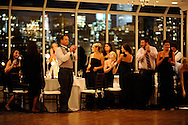Wedding reception in the Water's Edge restaurant, overlooking the East River and dramatic Manhattan skyline.