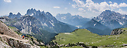 "The peaks of Cadini Group, Sorapiss Group, and Monte Cristallo rise (left to right) in the Dolomites, Veneto region, Italy, Europe. In the Cadini di Misurina, Cima Grande rises to 2999 meters (9839 feet), between Cima Piccola and Cima Ovest. Sorapiss (3205m) and Monte Cristallo are in the Ampezzo Dolomites. The Cadini Group is in the municipality of Auronzo di Cadore, in the Sesto Dolomites (Dolomiti di Sesto, or Sexten/Sextner/Sextener Dolomiten) which lie north of the Fiume Ansiei valley. From the Rifugio Auronzo toll road, hike for spectacular views around Tre Cime di Lavaredo (Italian for ""Three Peaks of Lavaredo,"" called Drei Zinnen or ""Three Merlons"" in German). The Dolomites are part of the Southern Limestone Alps. UNESCO honored the Dolomites as a natural World Heritage Site in 2009. This panorama was stitched from 6 overlapping photos."