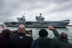 © Licensed to London News Pictures. 16/11/2019. Portsmouth, UK.  People waving as HMS Prince of Wales, the Royal Navy's second Queen Elizabeth-class aircraft carrier, sails into Portsmouth Naval Base for the first time this afternoon, 16th November 2019. The £3.1 billion warship has been undergoing eight weeks of sea trials in the Moray Firth. Photo credit: Rob Arnold/LNP