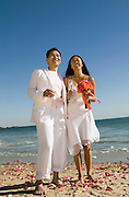 Newlyweds Standing on the Beach