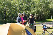 Cyclists prepare their campsites, ready for departure next morning on first day of the tour: Macklin to Wilkie.