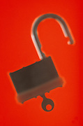 Lock and key on a bright red background