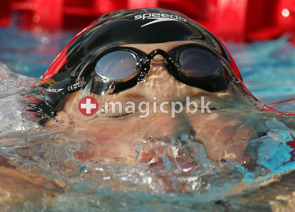 Swiss swimmer Hanna Miluska emerges from the water after her women's 200m freestyle qualifying heat at the Athens Olympic Aquatic Centre Monday 16 August 2004.          (Photo by Patrick B. Kraemer / MAGICPBK)