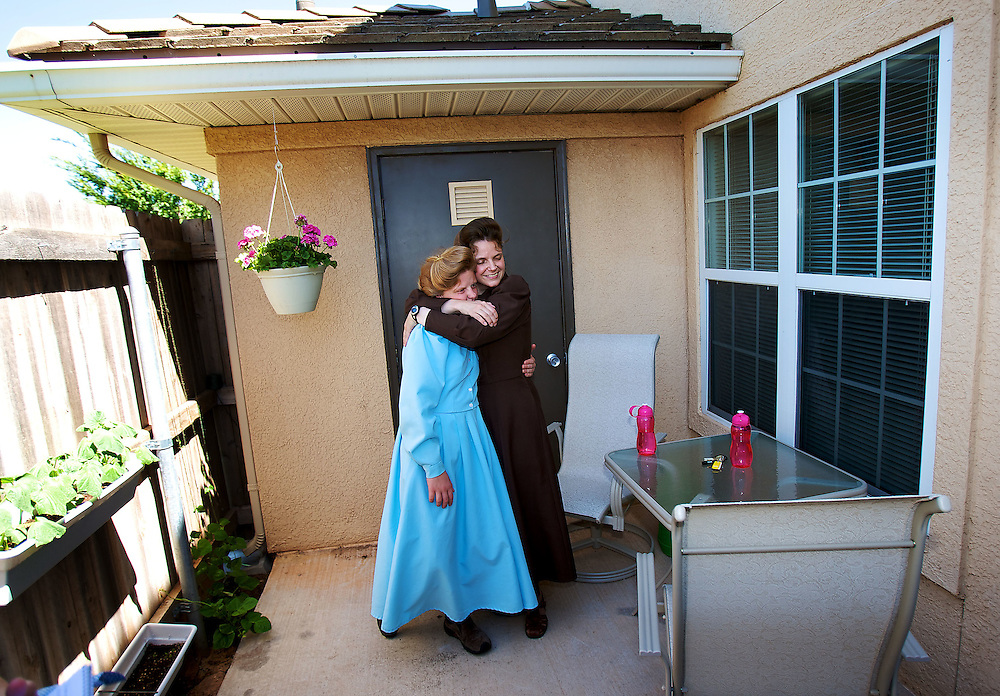FLDS mother Sarah Barlow Draper hugs her daughter Rebekah (cq) on the back porch of their home in Abilene, Texas on Monday June 2, 2008. They had reunited with their mother following the court order which released the children back into the custody of their mothers. August MIller/ Deseret News .