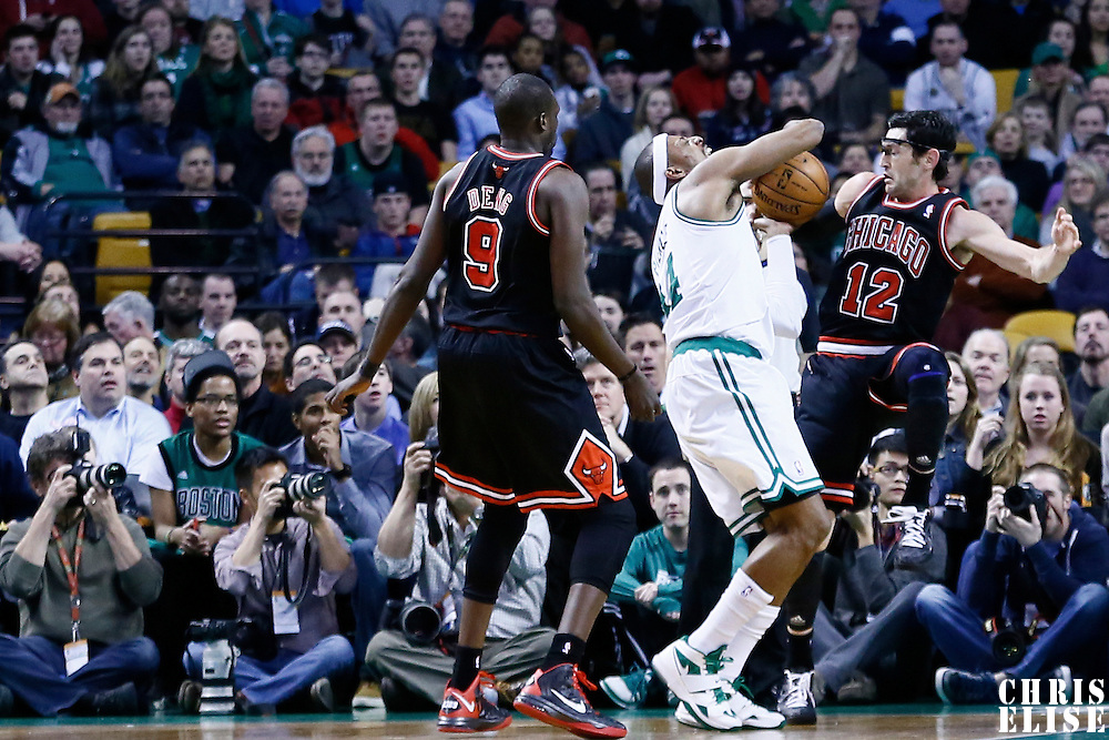 18 January 2013: Boston Celtics small forward Paul Pierce (34) is fouled by Chicago Bulls shooting guard Kirk Hinrich (12) during the Chicago Bulls 100-99 overtime victory over the Boston Celtics at the TD Garden, Boston, Massachusetts, USA.