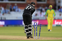 New Zealand's Lockie Ferguson is bowled out by Australia's Mitchell Starc during the ICC Cricket World Cup group stage match at Lord's, London.