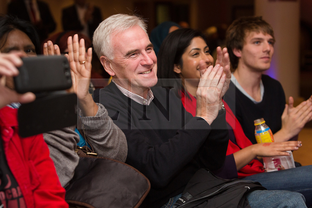© Licensed to London News Pictures. 24/10/2015. London, UK. Shadow Chancellor,  John McDonnell applauding speakers at the Labour Party Momentum event held at the Waterlilly in Whitechapel, east London. Momentum is a new successor entity to the Jeremy Corbyn for Labour Leader campaign which works with people who supports Corbyn's aim of creating a more fair, equal and democratic society. Photo credit : Vickie Flores/LNP