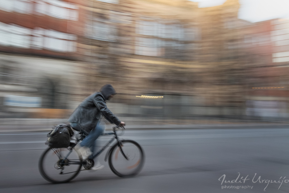 A cyclist traveling on the Oranienburger street
